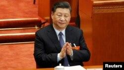中国国家主席习近平2019年3月8日在北京人大会堂出席全国人大会议。