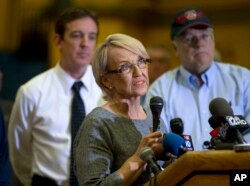 FILE - Arizona Gov. Jan Brewer answers questions during a news conference in Prescott, Arizona, July 1, 2013.