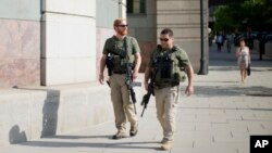 US Marshals patrol the area outside federal court in Washington, July 2, 2014, where Libyan militant Ahmed Abu Khatallah, charged in the deadly attack at the U.S. diplomatic outpost in Benghazi, is being held for a detention hearing.