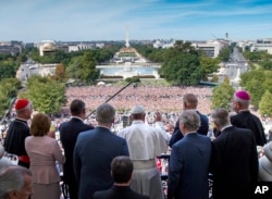 Pope Francis waves to the assembled crowd from the Speakers Balcony at the U.S. Capitol with members of Congress, Thursday, Sept. 24, 2015, in Washington after he addressed a joint meeting of Congress. (Doug Mills/The New York Times via AP, Pool)