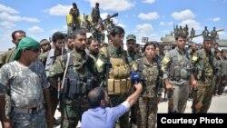 ພວກທະຫານ ທີ່ເຂົ້າຮ່ວມ ການໂຈມຕີເພື່ອປົດປ່ອຍ ເມືອງ Raqqa ໃນຊີເຣຍ.