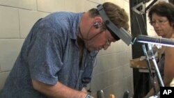 New Orleans resident Stefano Velaska makes jewelery from scraps of metal left by Katrina