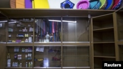 Shelves which would usually contain food for cats and dogs and others supplies sit almost empty in Caracas, Venezuela, Sept. 22, 2015.