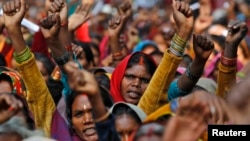 FILE - Women rally in New Delhi, India, Dec. 15, 2011.
