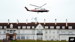 Presidential candidate Donald Trump leaves by his helicopter from the Turnberry golf course in Turnberry, Scotland, Aug. 1, 2015.
