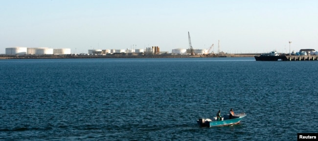 FILE - A speed boat passes by oil docks at the port of Kalantari in the city of Chabahar, 300km (186 miles) east of the Strait of Hormuz.