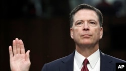 """FILE - Former FBI Director James Comey is sworn in during a Senate Intelligence Committee hearing on Capitol Hill in Washington, June 8, 2017. His publisher is moving up the release date of his memoir """"A Higher Loyalty,"""" to April 17."""