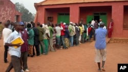 FILE - People stand in line to vote at a school serving as a polling station in Bangui, capital of the Central African Republic in a past election.