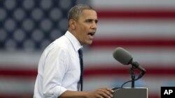 Presiden Barack Obama memberikan pidato dalam kampanye di Universitas Iowa, di Iowa City, negara bagian Iowa, Jumat (7/9).