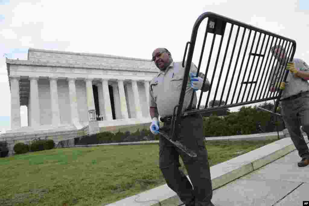 National Park Service employees remove barricades from the grounds of the Lincoln Memorial in Washington, Thursday, Oct. 17, 2013.