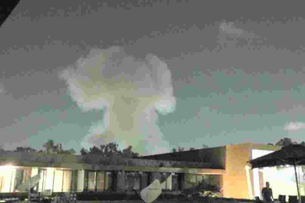 Smoke rises above buildings in Tripoli May 24, 2011.