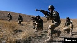 Afghan National Army (ANA) soldiers take part in a training exercise at a military base in Kabul Nov. 23, 2014.