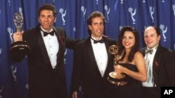 """Seinfeld' cast members, from left, Michael Richards, Jerry Seinfeld, Julia Louise-Dreyfus and Jason Alexander backstage at the Emmy Awards in Pasadena, California, in 1993"