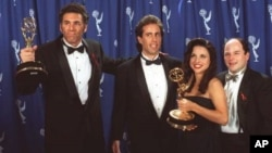 The cast of ``Seinfeld,'' from left to right, Michael Richards, Jerry Seinfeld, Julia Louise-Dreyfus and Jason Alexander, pose backstage with their awards at the 45th Annual Emmy Awards in Pasadena, Calif., Sept. 19, 1993. (AP Photo/Douglas C. Pizac)