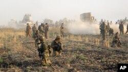 ກຳລັງ Peshmerga ຂອງຊາວເຄີດ ທີ່ໄດ້ຖືກສົ່ງໄປປະຕິບັດງານ ຍຶດເອົາໝູ່ບ້ານຄືນ ຈາກກຸ່ມລັດອິສລາມ.