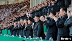 North Korean leader Kim Jong Un gestures during a men's football match between Sonbong and Hwoebul teams for the Mangyongdae Prize Sports Games at Kim Il Sung Stadium, in this undated photo released by North Korea's Korean Central News Agency April 14, 2015.