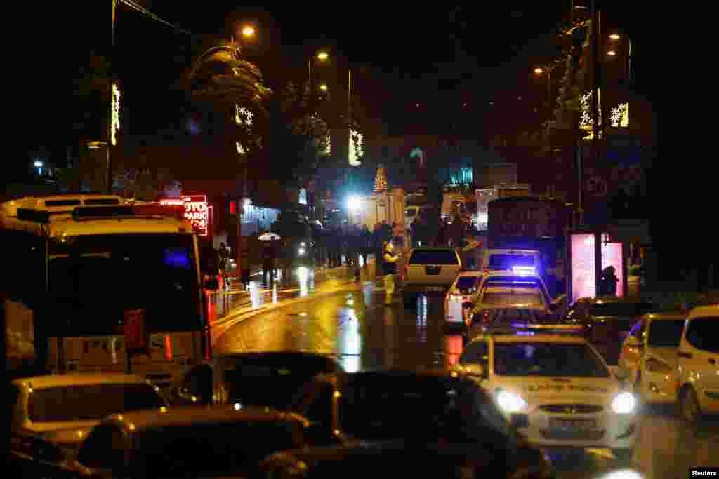 Police forensic experts examine an area near an Istanbul nightclub, following a gun attack, Jan. 1, 2017.