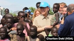 UN Secretary General Ban Ki-moon visits a UN compound in Juba on May 6, 2014, where thousands of displaced people have sought shelter. The hair of many of the children is beginning to turn red, a sign of malnutrition.