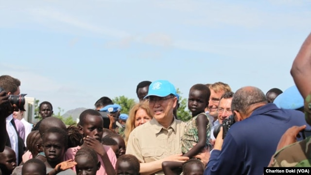 UN Secretary General Ban Ki-moon holds a child as he visits a UN compound in Juba on May 6, 2014, where thousands of displaced persons have sought shelter. The hair of many of the children is beginning to turn red, a sign of malnutrition.