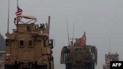 지난해 12월 말 시리아 북부 만지브에서 미군 차량들이 줄지어 이동하고 있다.