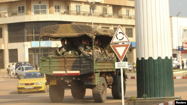 A military vehicle carrying French soldiers patrols a street near the presidential palace in Bangui, December 31, 2012.