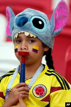 A child wears a jersey of the Colombia's national soccer team prior to the start of the group H match between Poland and Colombia at the 2018 soccer World Cup at the Kazan Arena in Kazan, Russia, Sunday, June 24, 2018. (AP Photo/Frank Augstein)