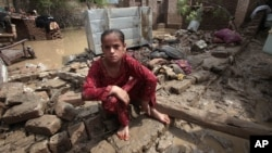 A Pakistani girl in what is left of her house in Nowshera, near Peshawar, Pakistan, Aug. 22, 2012.