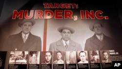 An exhibit featuring a target of the G men, Murder, Inc. is pictured at The Mob Museum on Monday, Feb. 13, 2012, in Las Vegas. (AP Photo/Isaac Brekken)