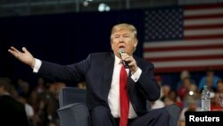 Republican presidential candidate Donald Trump addresses the crowd during a forum in Aiken, S.C., Dec. 12, 2015.