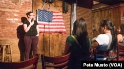 Comedian Katherine Jessup tells jokes at the Town Tavern open mike in Washinston, DC. (Peter Musto/VOA)