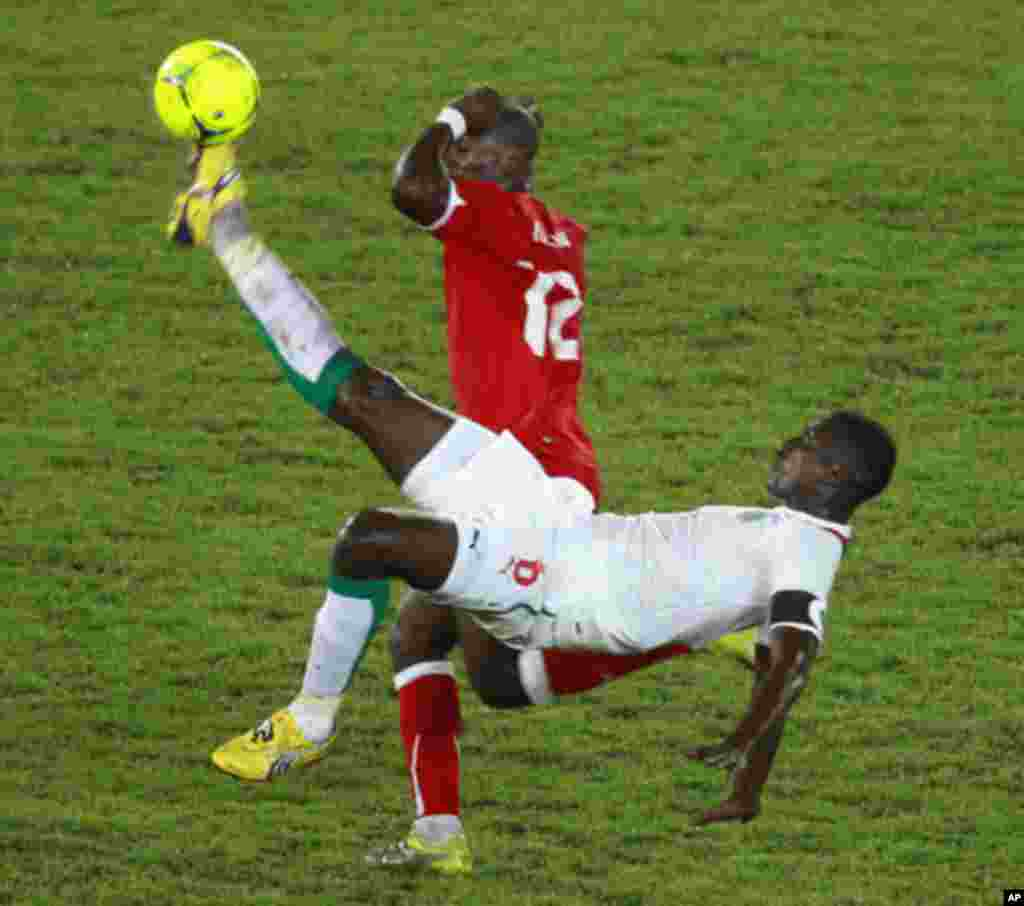 Fidjeu of Equatorial Guinea challenges Kader Mangane of Senegal during their African Nations Cup Group A soccer match at Estadio de Bata