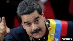 Venezuela's President Nicolas Maduro gestures as he arrives for a session of the National Constituent Assembly at Palacio Federal Legislativo in Caracas, Venezuela, Aug. 10, 2017.