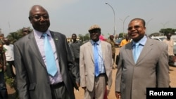 FILE - Martin Ziguele, left, former Central African Republic prime minister, and Nicolas Tiangaye, right, appear at the Bangui airport Jan. 7, 2013. Both are candidates in the next presidential race.
