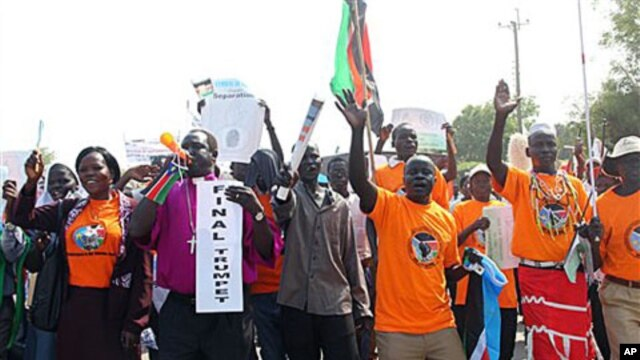 Southern Sudanese citizens clog the streets of the southern capital Juba as they march in support of the upcoming independence referendum, Dec 9, 2010