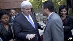Former Republican presidential candidate Newt Gingrich meets with Asian-Americans at a campaign stop earlier this year.