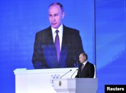 Russian President Vladimir Putin addresses Russian lawmakers, regional governors and other high-ranking officials, in Moscow, Russia, March 1, 2018.