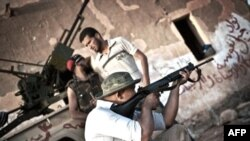 Озброєний лівійський постанець.