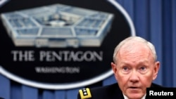 FILE - U.S. Joint Chiefs Chairman General Martin Dempsey speaks to reporters in Washington, Sept. 26, 2014.