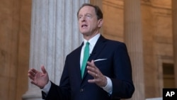 FILE - Sen. Pat Toomey, R-Pa., discusses President Donald Trump's revamped North American trade agreement with Canada and Mexico during a television news interview on Capitol Hill in Washington, Oct. 2, 2018.
