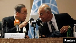 U.N. chief Ban Ki-moon, left, confers with the deputy house speaker in Tobruk, Emhemed Shoaib, in Tripoli Oct. 11, 2014.