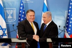 FILE - Israeli Prime Minister Benjamin Netanyahu shakes hands with U.S. Secretary of State Mike Pompeo during a meeting at the Ministry of Defense in Tel Aviv, Israel, April 29, 2018.