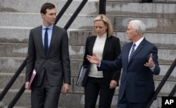 White House senior adviser Jared Kushner, Homeland Security Secretary Kirstjen Nielsen and Vice President Mike Pence talk as they walk down the steps of the Eisenhower Executive Office Building on the White House complex, Jan. 5, 2019, in Washington.