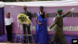 Rwandan President Paul Kagame (2nd from Left) and Rwandan First Lady, Jeanette Kagame, lay a wreath at the Genocide Memorial in Kigali on April 7, 2012.