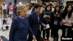 U.S. Democratic presidential nominee Hillary Clinton leaves after an unscheduled news conference on FBI inquiries about her emails after a campaign rally in Des Moines, Iowa, Oct. 28, 2016.