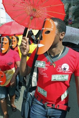 A masked sex worker leads a protest demanding basic human rights, in Nairobi, Kenya, March 6, 2012.