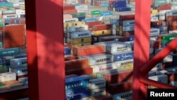 FILE - Containers are seen at the Yangshan Deep Water Port in Shanghai, China, Sept. 24, 2016.
