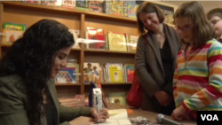 Hena Khan signing books in Washington, D.C.