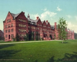 Colleges are going green - just not this kind. This postcard view of a Vassar College dormitory and spacious greensward in Poughkeepsie, New York, was created in 1904.