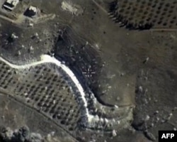 FILE - A video grab made on September 30, 2015, shows an image taken footage made available on the Russian Defense Ministry's official website, purporting to show an airstrike in Syria.