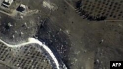 An image from a video made Sept. 30, 2015, and shown on the Russian Defense Ministry's official website, purports to show an airstrike in Syria.
